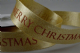 CR Ribbon: Gold Ribbon with Merry Christmas 25mm